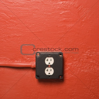 Wall with electrical outlet.