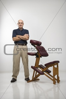 Massage therapist and chair.
