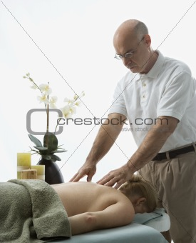 Man massaging woman.