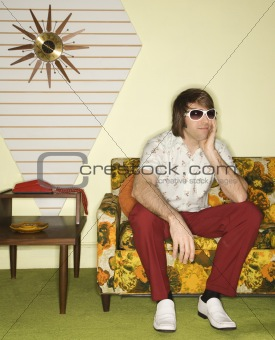 Man sitting on sofa.