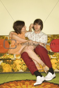 Couple on sofa.