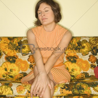 Woman sitting on sofa.