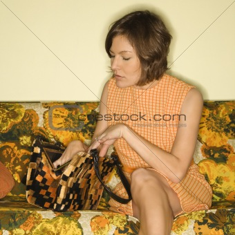 Woman sitting on sofa.