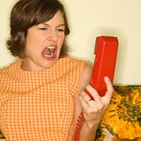 Woman screaming at phone.