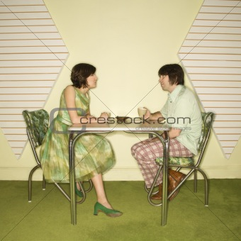 Couple sitting at table.