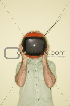 Television replacing man's head.