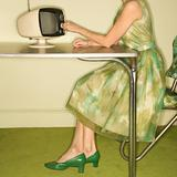 Woman dialing television.