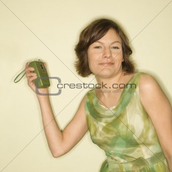 Woman with handheld radio.