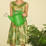 Woman holding watering can.