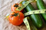 Tomato & cucumber with measuring tape