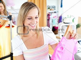 Bright woman selecting item