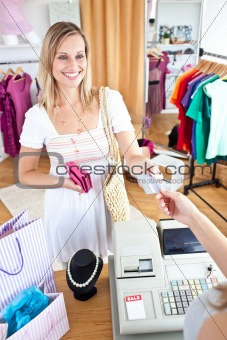 Caucasian woman is paying items