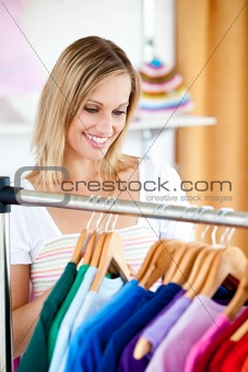 Blond woman is doing shopping
