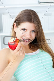 Positive woman eating an apple