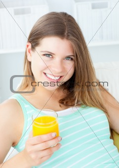 Charming woman drinking orange juice