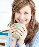 Positive attractive businesswoman holding a cup