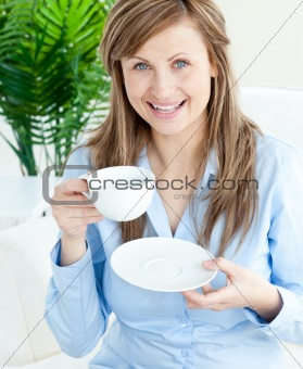 Bright businesswoman holding a cup