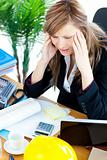 Stressed businesswoman having a headache