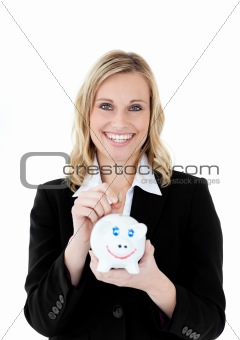 Charming businesswoman saving money in a piggy-bank