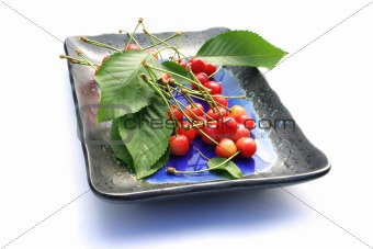 Fresh cherries on a plate