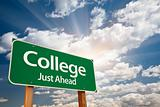 College Just Ahead Green Road Sign with Dramatic Clouds, Sun Rays and Sky.