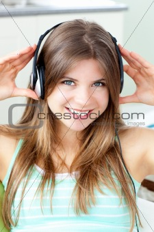 Positive woman listening to music with headphones