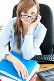 Smilling female doctor with glasses sitting in office 