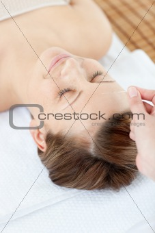 Acupuncture needles on a cauasian woman's head