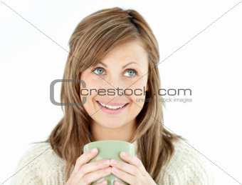 Caucasian woman holding a cup a coffee