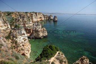Cliffs at Atlantic Ocean coast in Algarve, Portugal