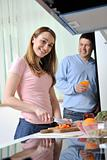 couple have fun and preparing healthy food in kitchen