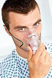 Patient having flu wearing a mask and looking at the camera