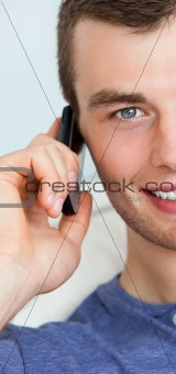 Portrait of young charming man using his phone