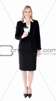 A happy businesswoman holding a cup of cofffe