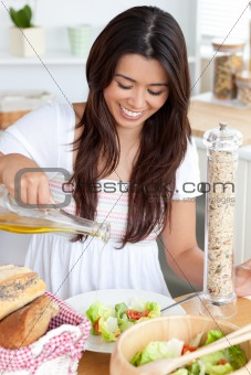 Attractive woman prepare a salad