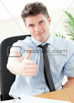 Charismatic businessman holding out his hand