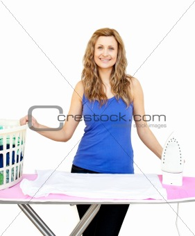 Beautiful woman behind an ironing board