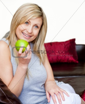 Bright woman eating an apple