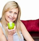 Joyful woman eating an apple