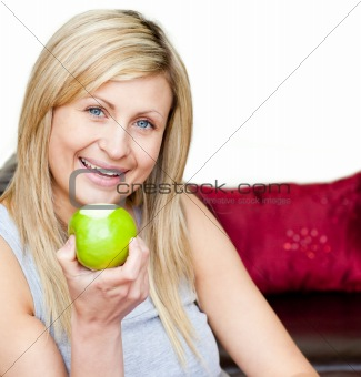 Joyful woman eating an apple
