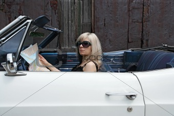 Blond female in convertible car