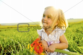 Adorable Girl outside with flowers