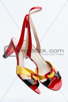 Pair of bright summer female footwear