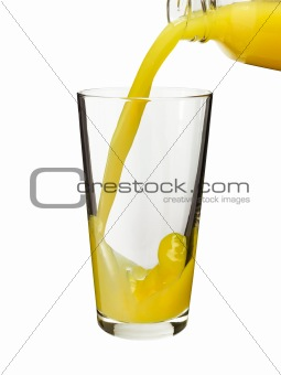 Pouring orange juice in a glass
