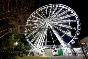 Ferris Wheel glowing at night