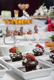 Asian Fusion appetizers and desserts on table