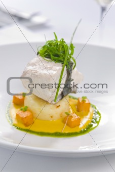 fish served with potato and sauce