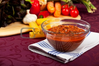 bowl with sauce bolognese and raw vegetables