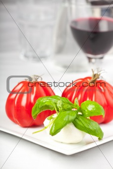tomatoes, mozzarella, basil and red wine