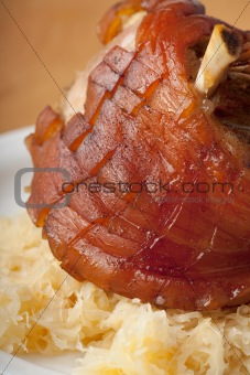 grilled knuckle of pork on a wooden table